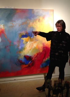 Laura Edwards in front of painting